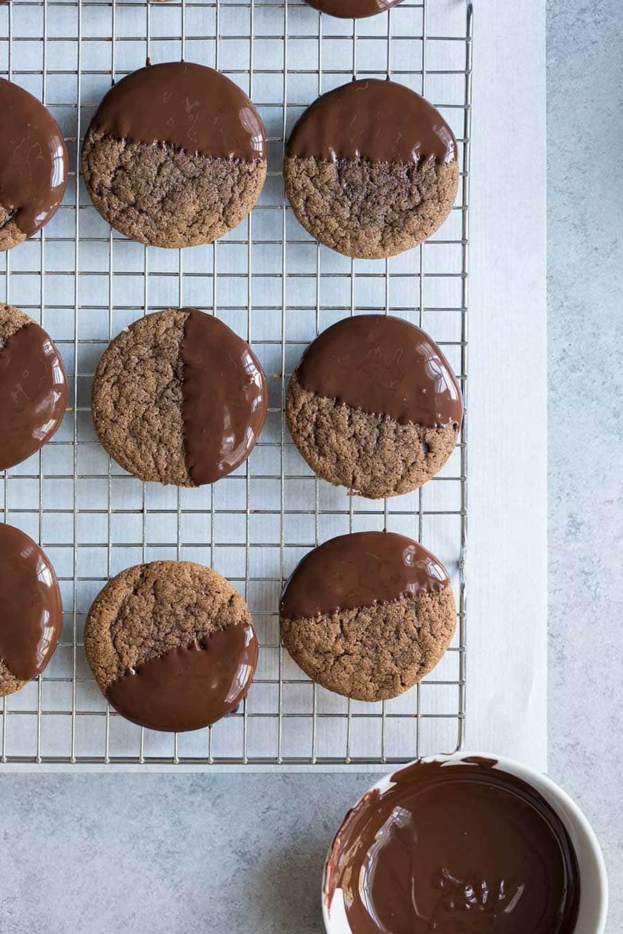 Baked gingerbread cookies freshly dipped in chocolate