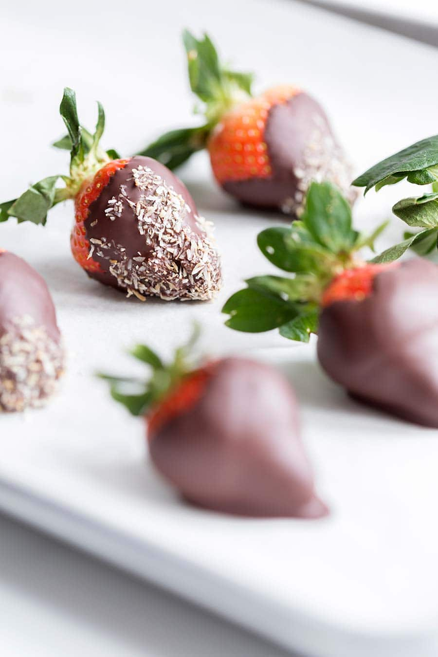 A photo of chocolate strawberries coated in toasted coconut.