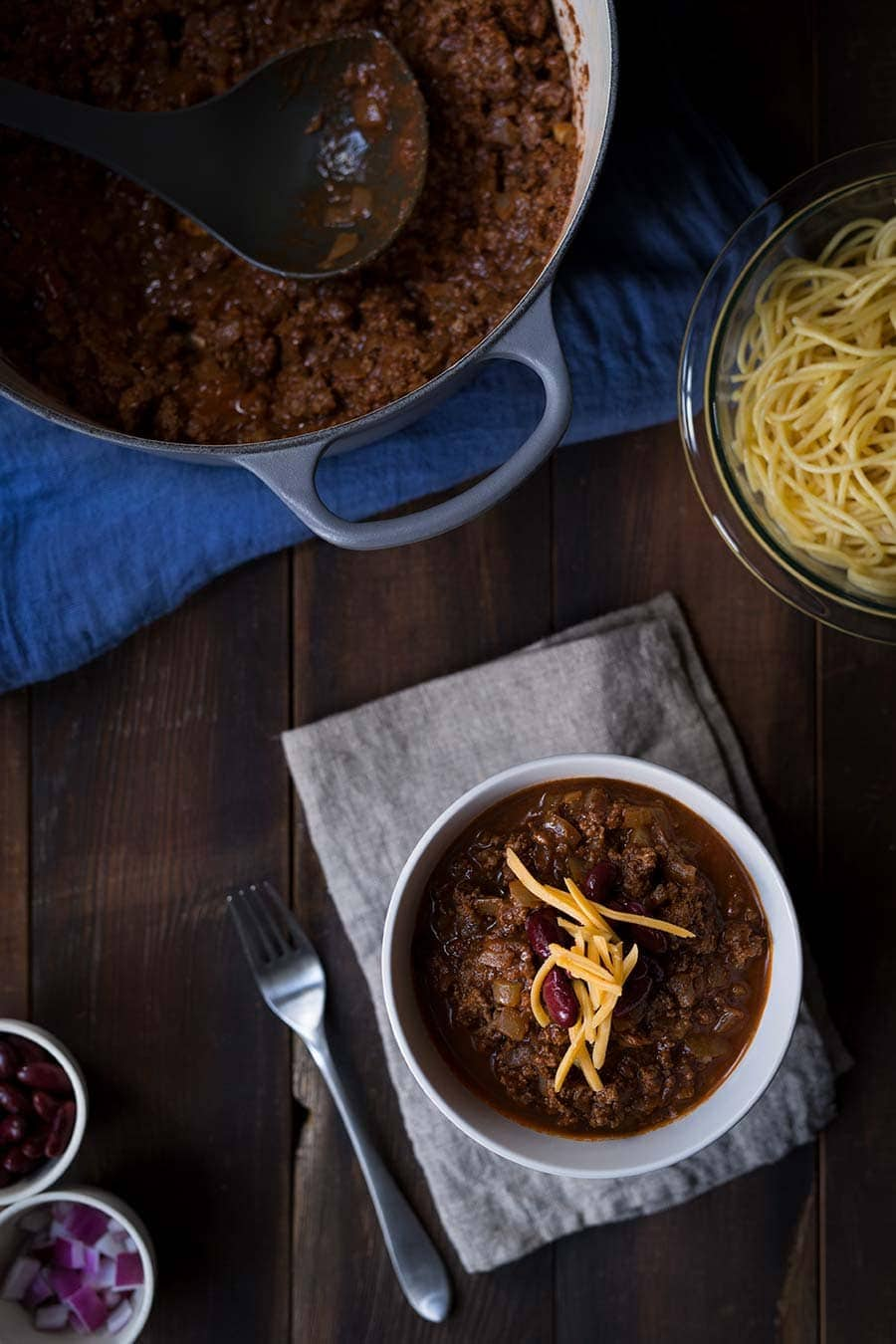 Cincinnati chili has a unique blend of Mediterranean spices, and can be served on it's own, as a meat sauce over spaghetti, or with the additions of cheese, onions and beans (aka two-way, three-way, four-way, and five-way!)