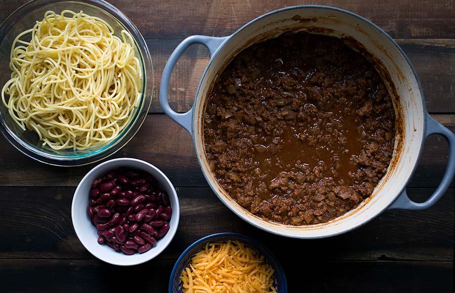 A Cincinnati chili recipe including classic garnishes.