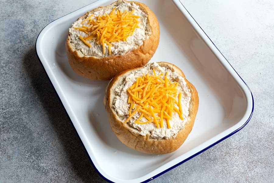 Cheese sprinkled over the hot crab dip prior to baking