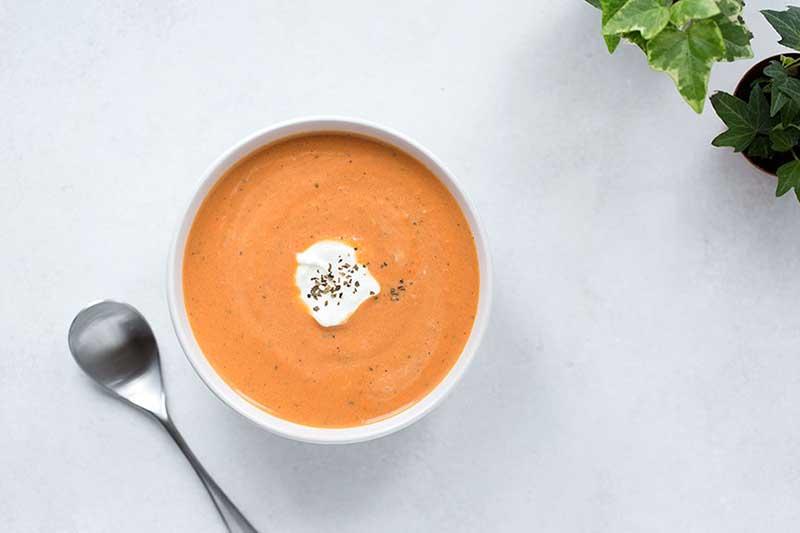 An overhead photo of tomato basil soup.