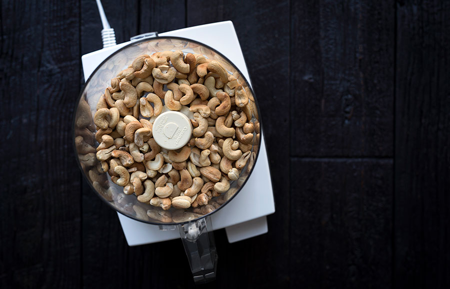 How to make cashew butter - whole roasted cashews in a food processor.