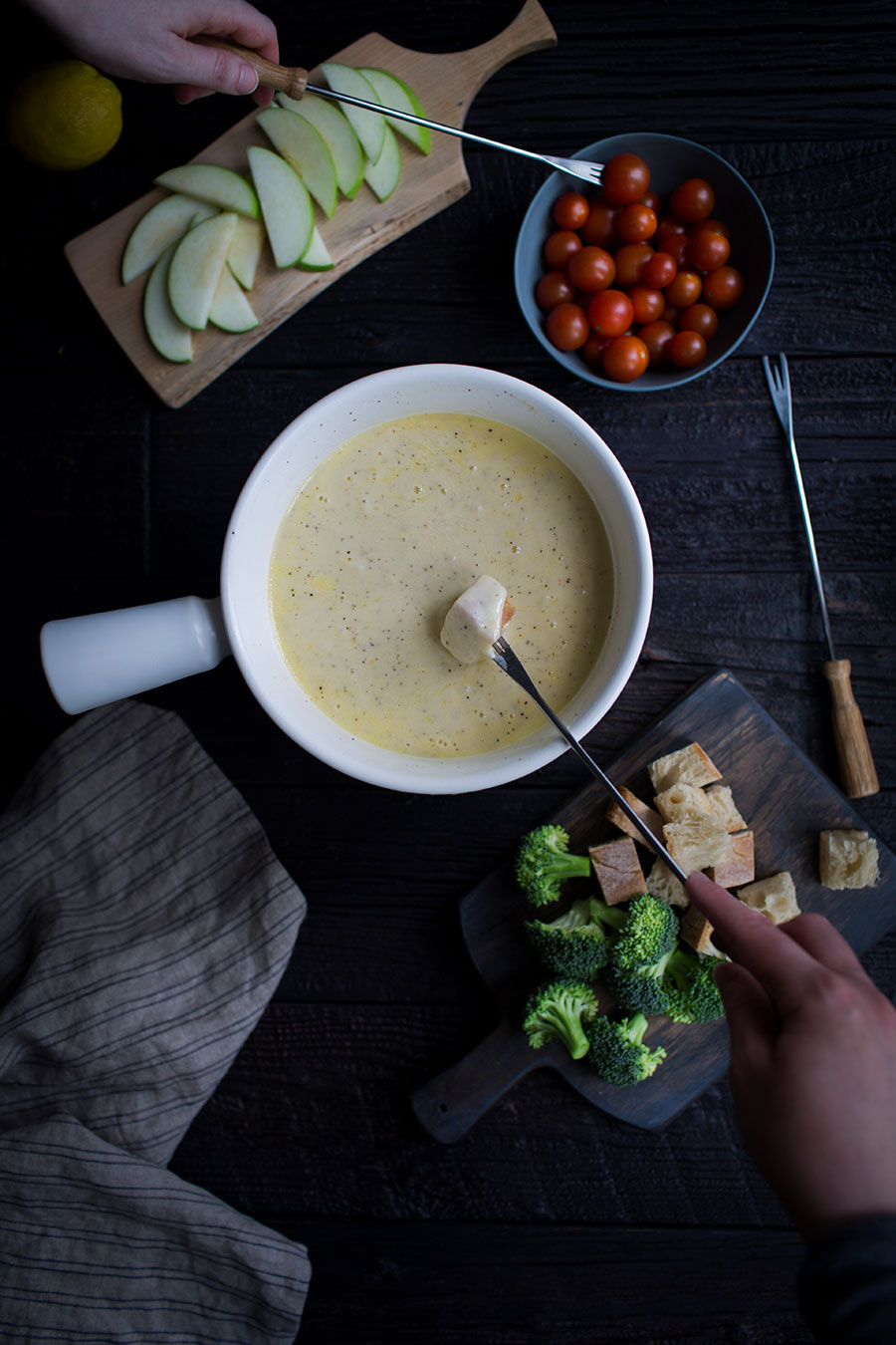 This Classic Swiss Cheese Fondue Recipe uses Emmentaler and Gruyére cheese, and it's PERFECT for fondue parties. When you get the recipe, be sure to also check out my fondue party tips!