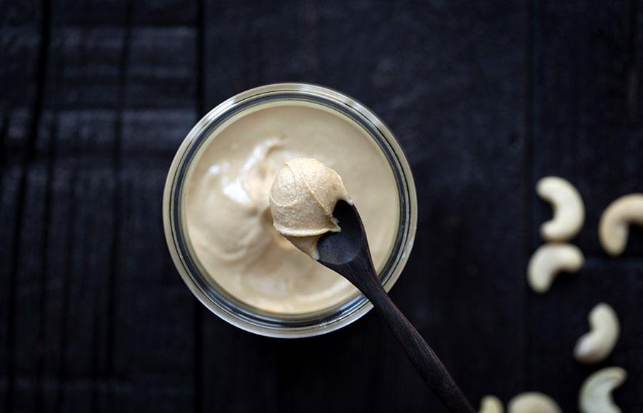 A macro photo of homemade creamy cashew butter.