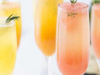 A photo of multiple grapefruit mimosas