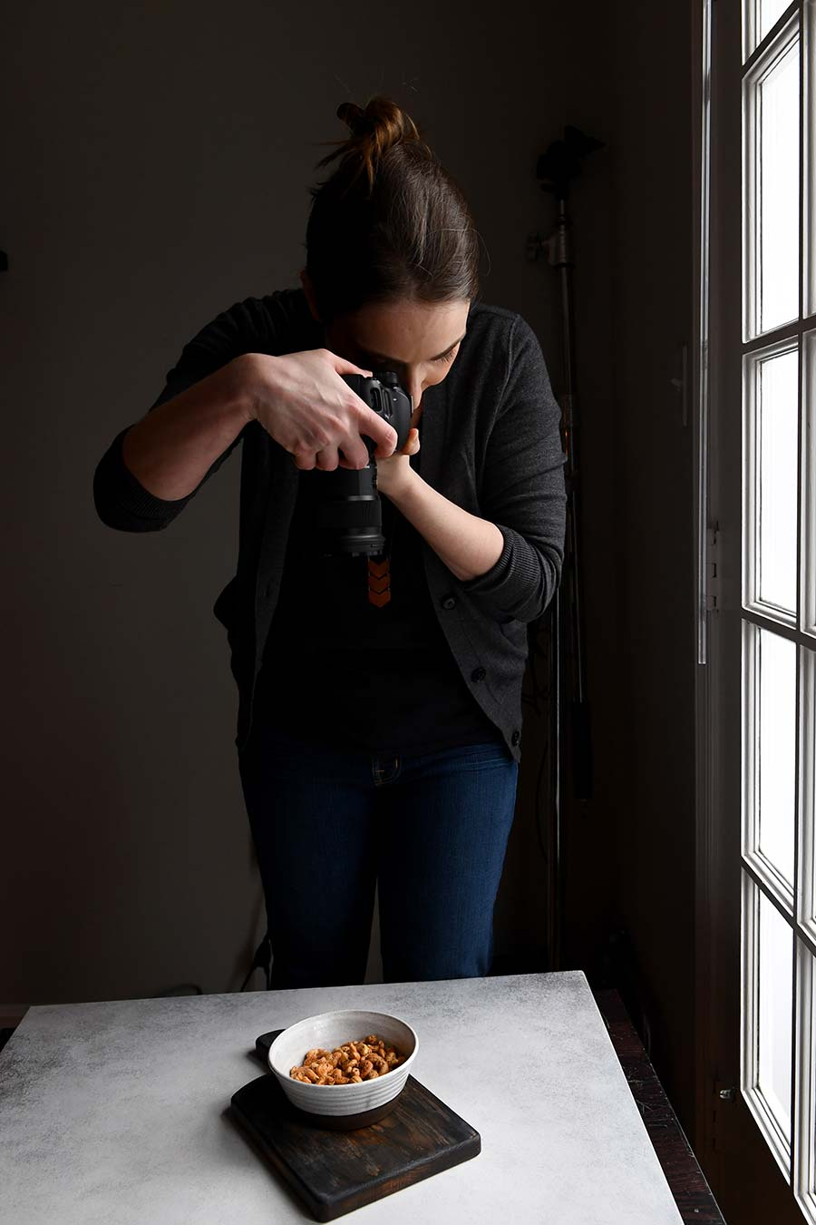 Jennifer Farley, creator of Savory Simple, photographing in her home studio.