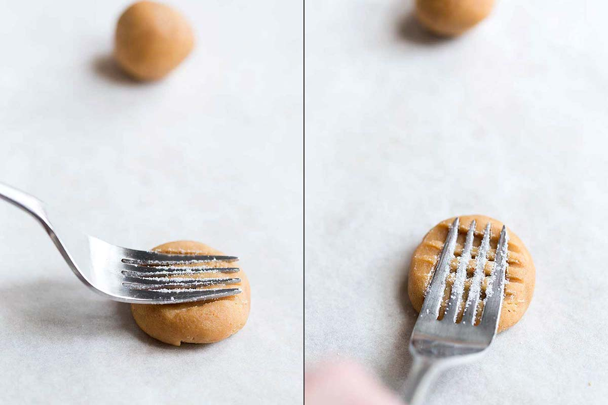 Using fork to shape peanut butter cookies
