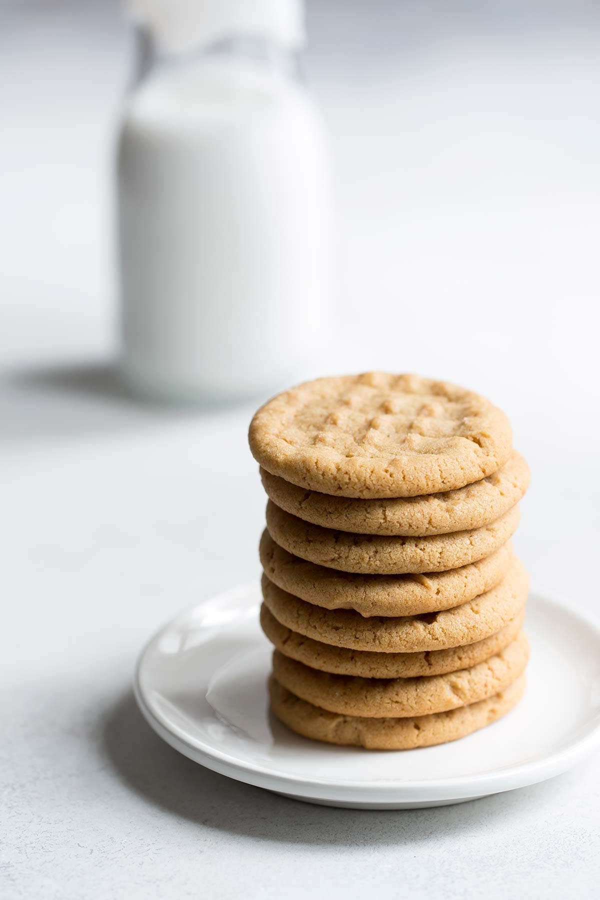 A photo of the finished homemade peanut butter cookies on a white plate.