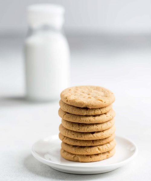Peanut butter cookie recipe stacked on a plate