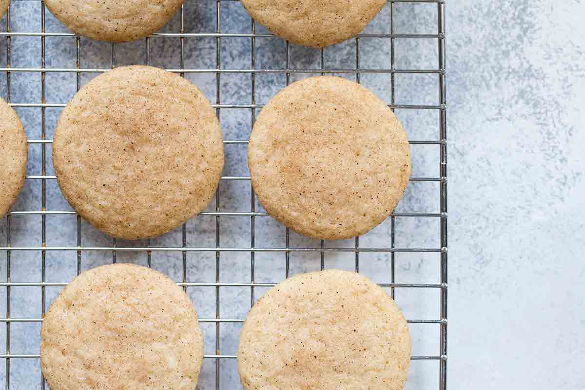 Snickerdoodles on a cooling rack.
