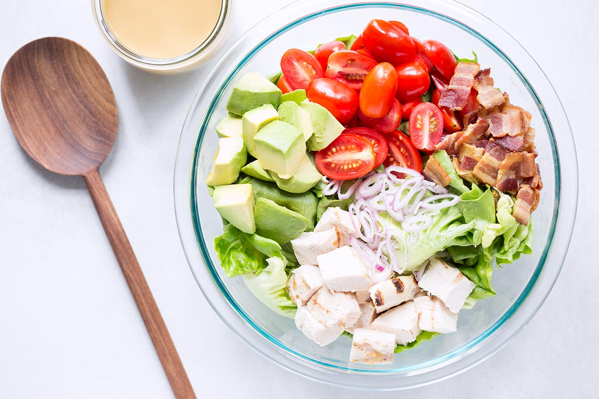 An overhead shot of an avocado chicken salad recipe in a large bowl