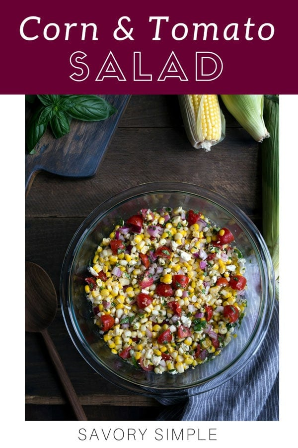 This summer corn salad is a perfect way to enjoy seasonal produce! Other ingredients include red onion, tomatoes, basil, and feta (omit for a vegan salad). #cornsalad #corntomatosalad #summersalad #savorysimple