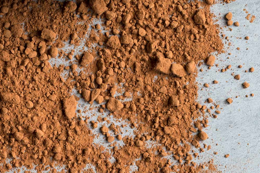 Natural cocoa powder, spread out on a slate board