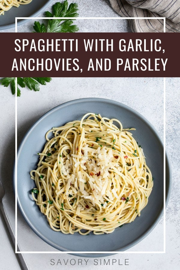 This Anchovy Pasta with Garlic and Parsley is a quick meal that comes together in about 20 minutes. Crushed red pepper adds warmth. #pastarecipe #spaghetti #easydinner #savorysimple