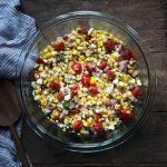 Close up photo of corn salad in a bowl.