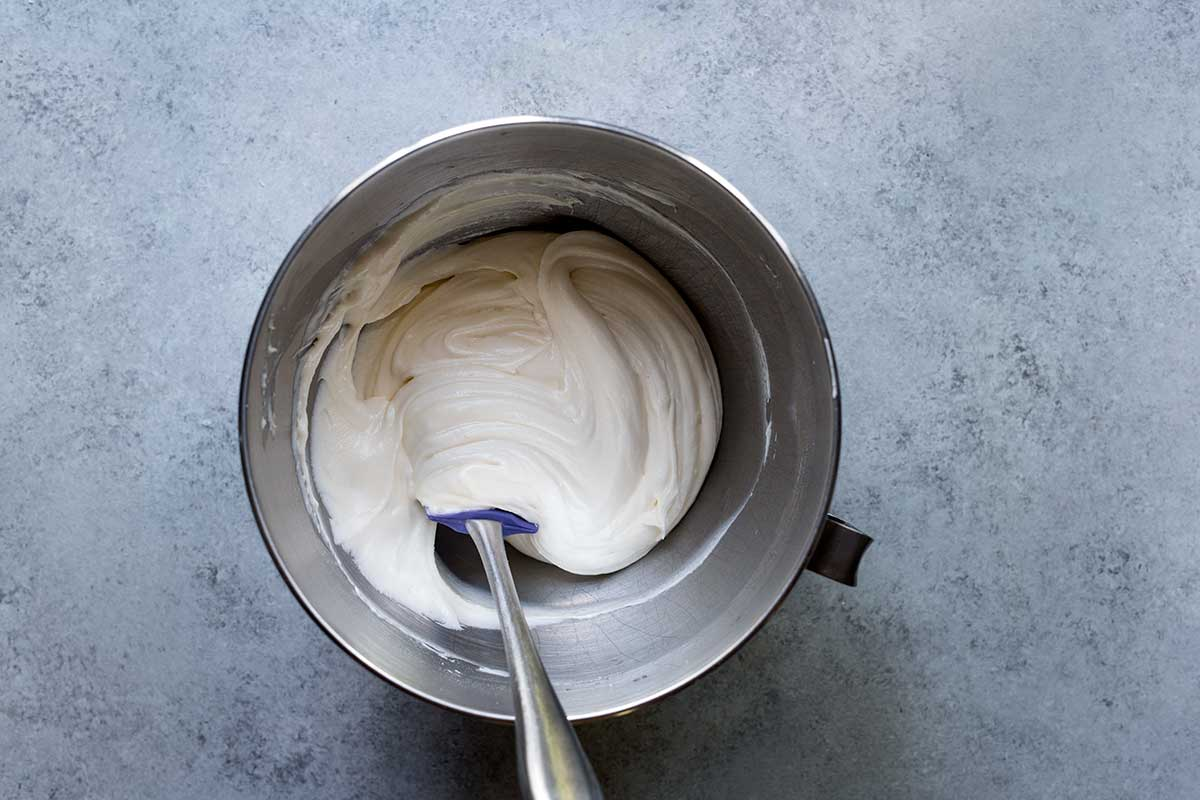 An overhead shot of cream cheese frosting.