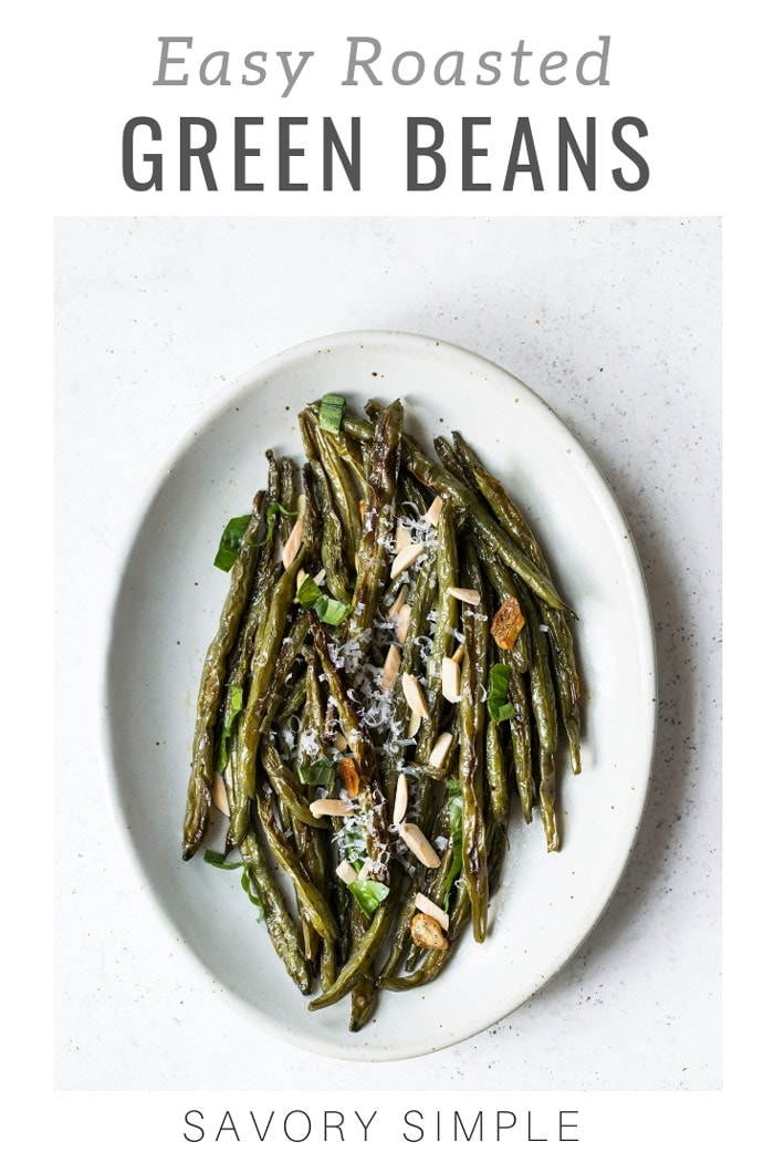These roasted green beans and crisp and flavorful, seasoned with parmesan cheese, garlic, lemon juice, and slivered almonds! Roasted green beans are a perfect side dish to serve alongside your favorite dinner. #greenbeans #roastedvegetables #sidedish #savorysimple