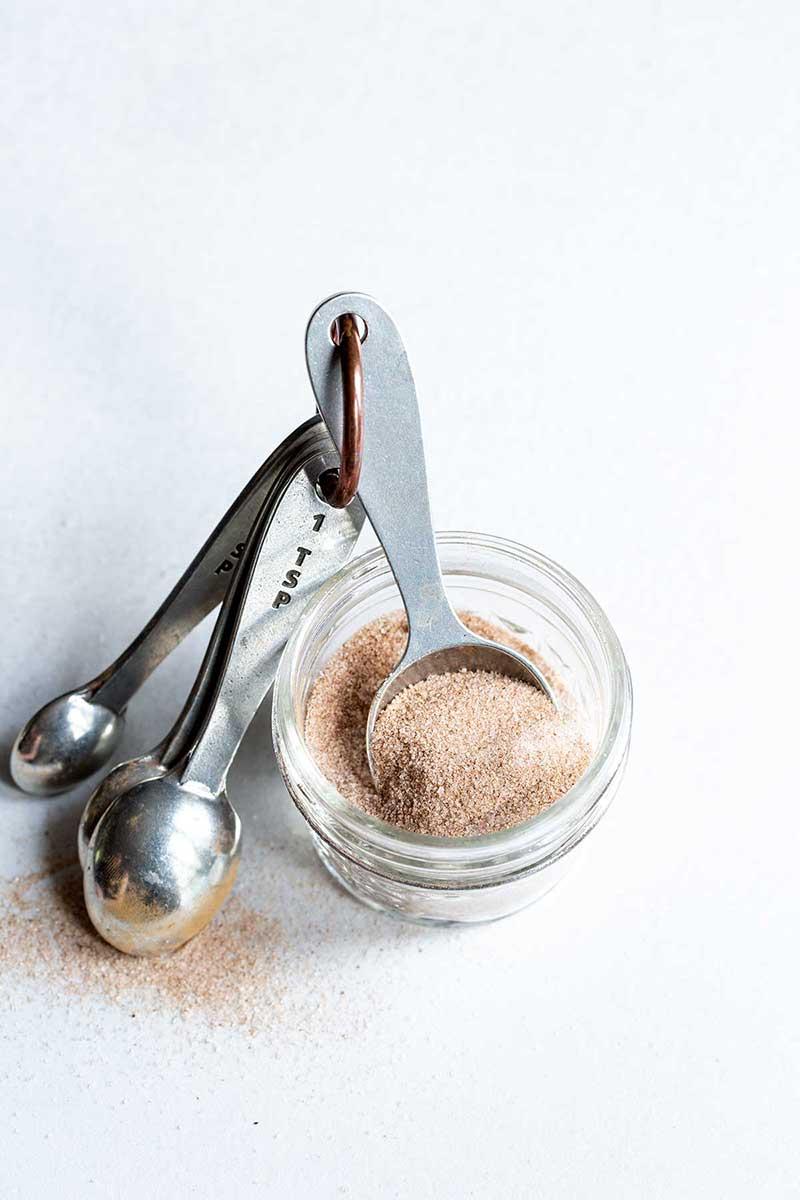 Cinnamon-Sugar Recipe in a mason jar with measuring spoons