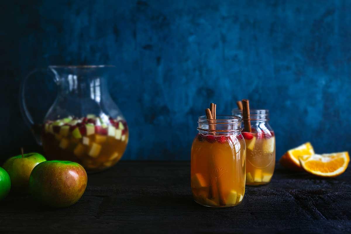 Apple cider sangria on a dark wood backdrop
