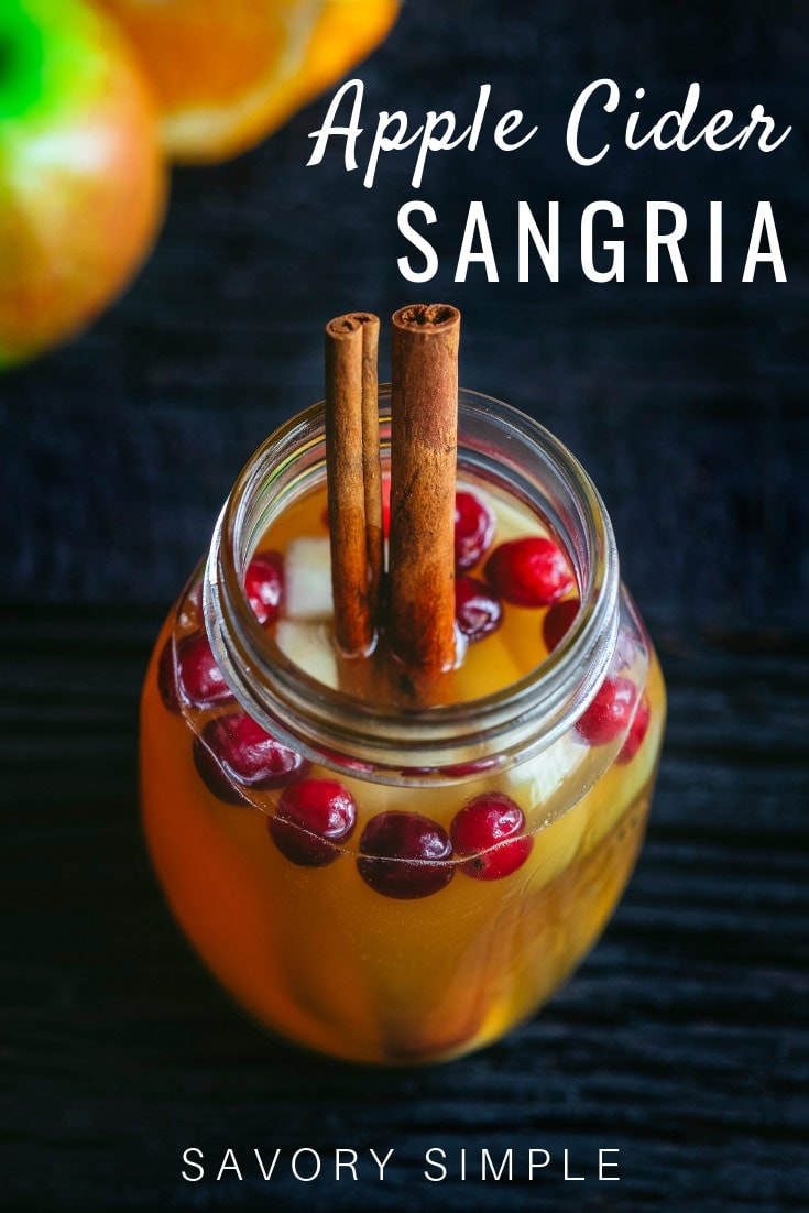 This Apple Cider Sangria is a fragrant, delicious holiday cocktail. It's beautiful, and it comes together in no time. Your friends and family will love it! #applecider #holidaydrinks #cocktails #savorysimple