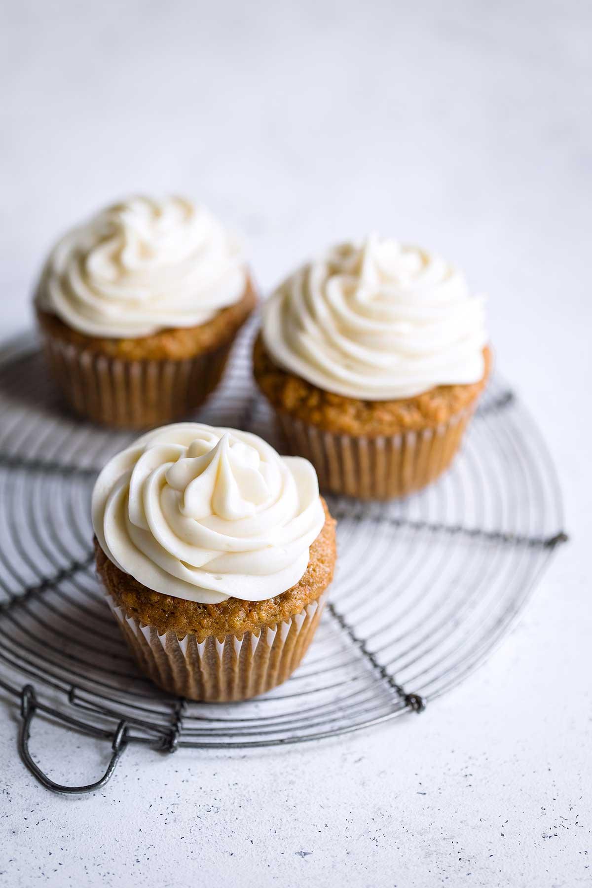 Closeup of three carrot cupcakes