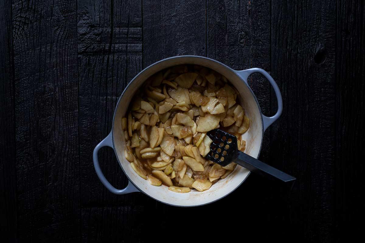 Apple pie filling in a Dutch oven.