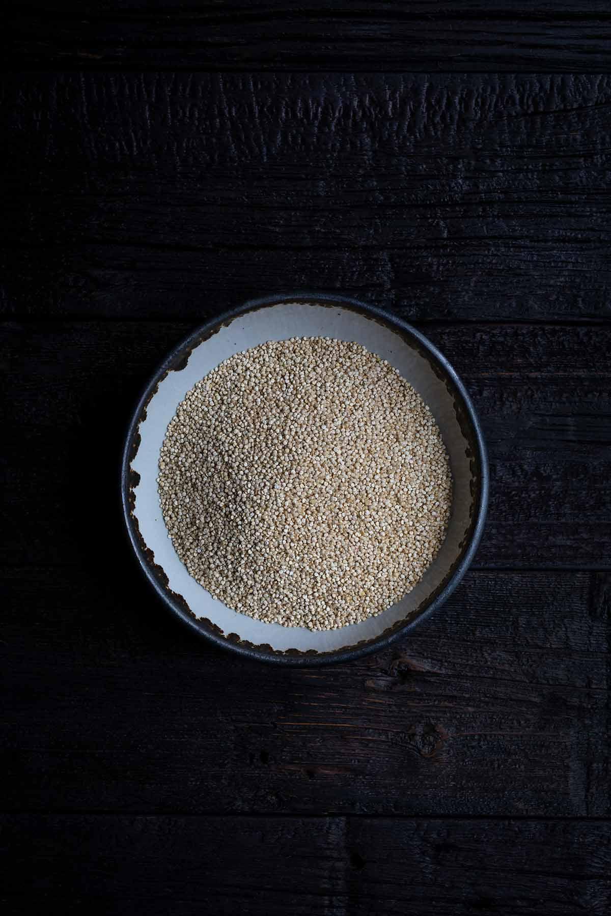 Uncooked white quinoa in a bowl