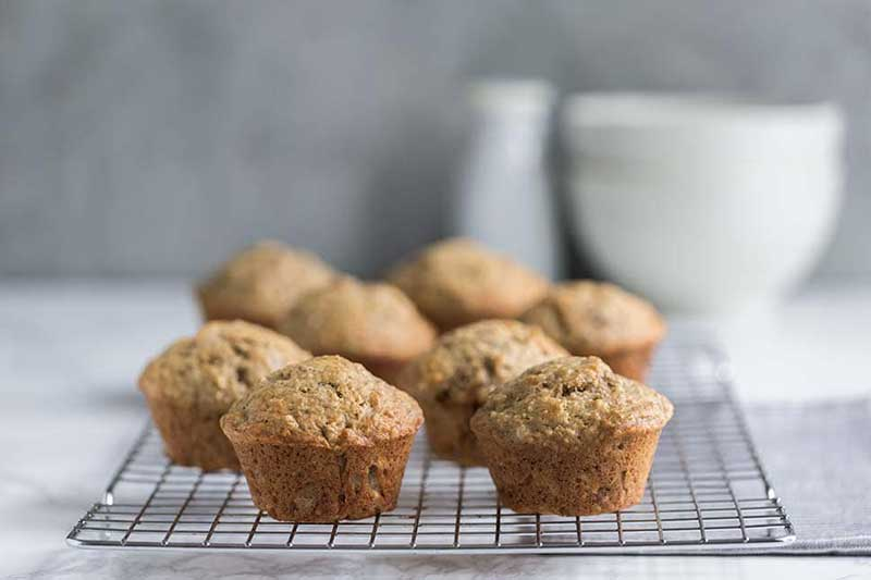 A photo of banana bread muffins on a cooling rack