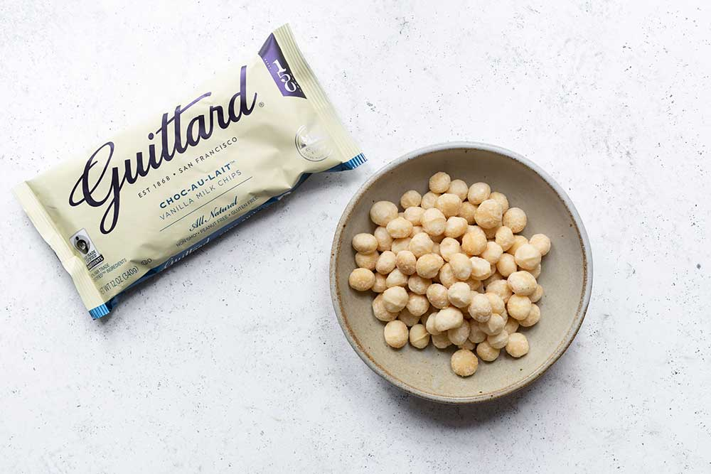 Guittard white chocolate chips and raw macadamia nuts