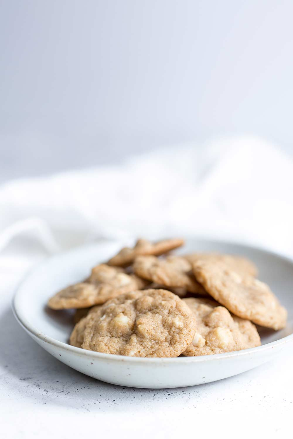White chocolate macadamia nut cookies in a serving bowl