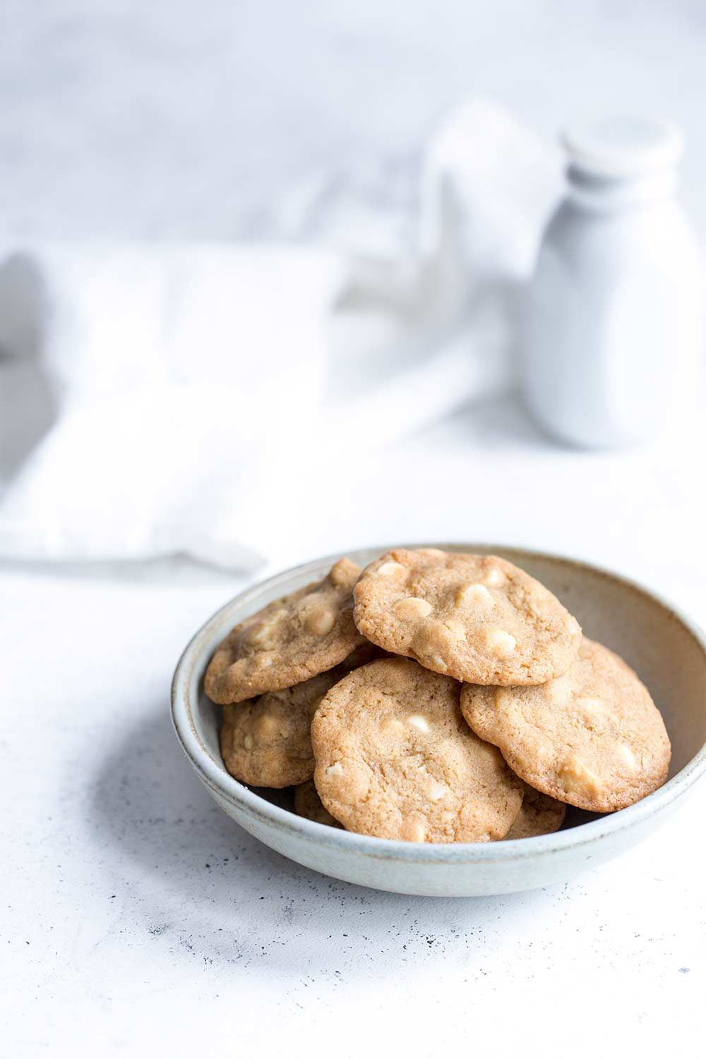White chocolate macadamia nut cookies in a bowl