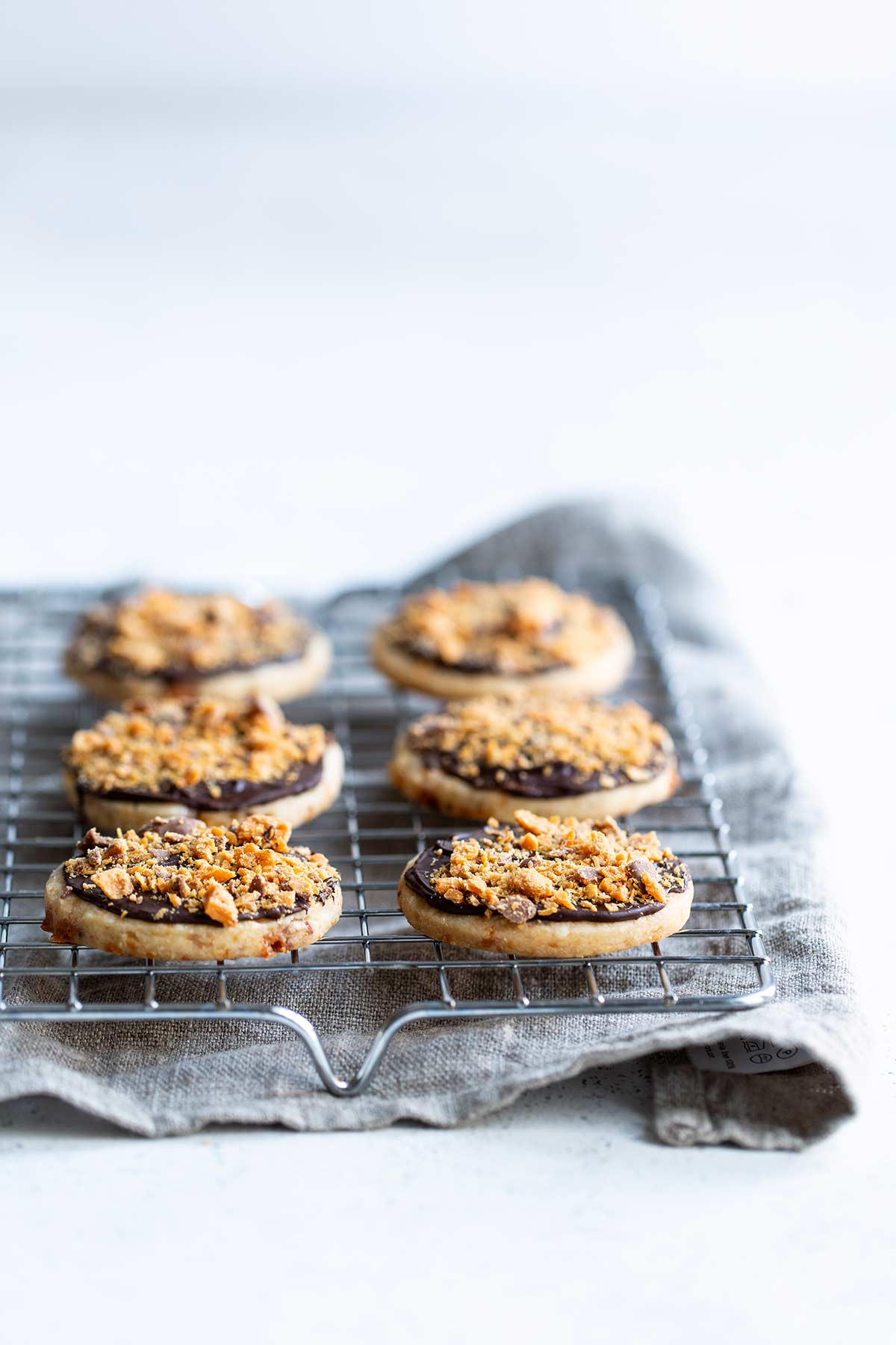 Butterfinger Shortbread Cookies on a cooling rack
