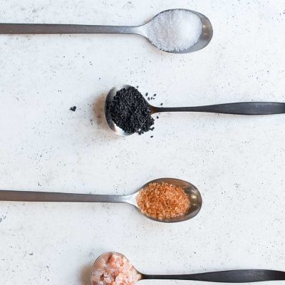 Assorted types of salt on spoons
