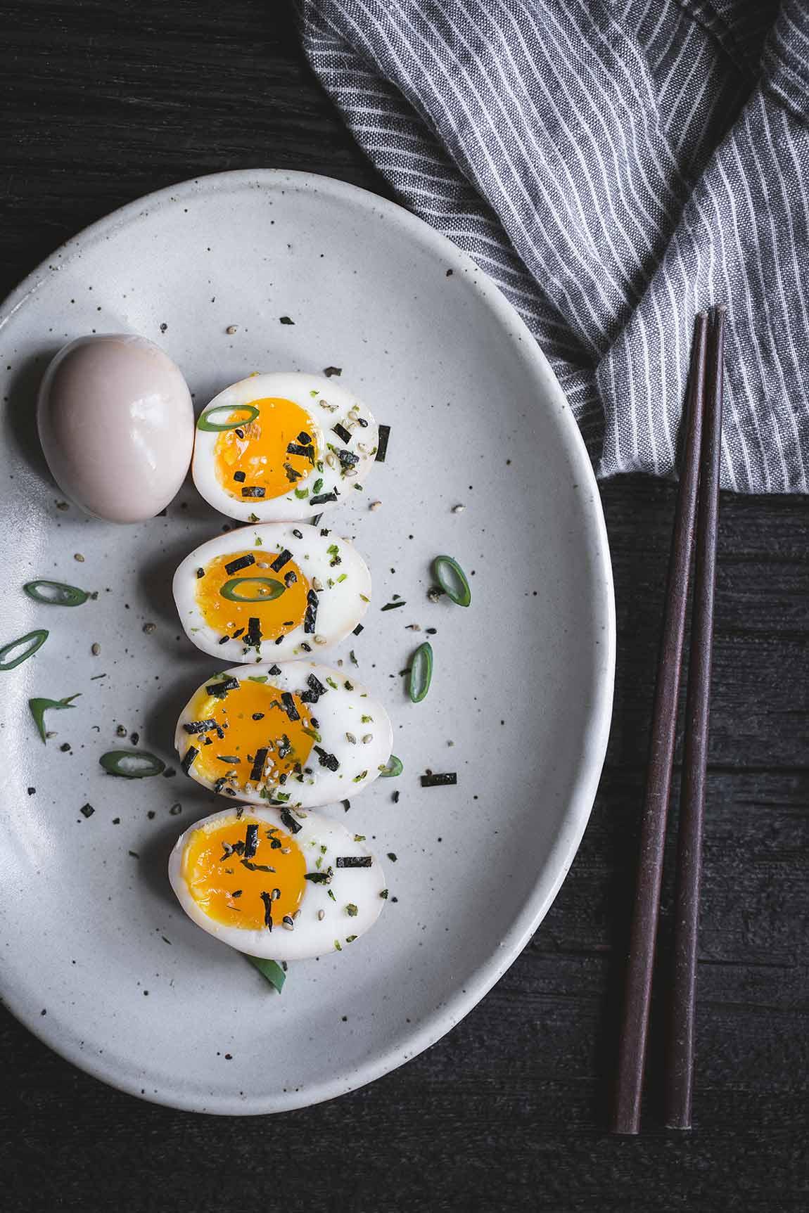 Ramen eggs with chopsticks