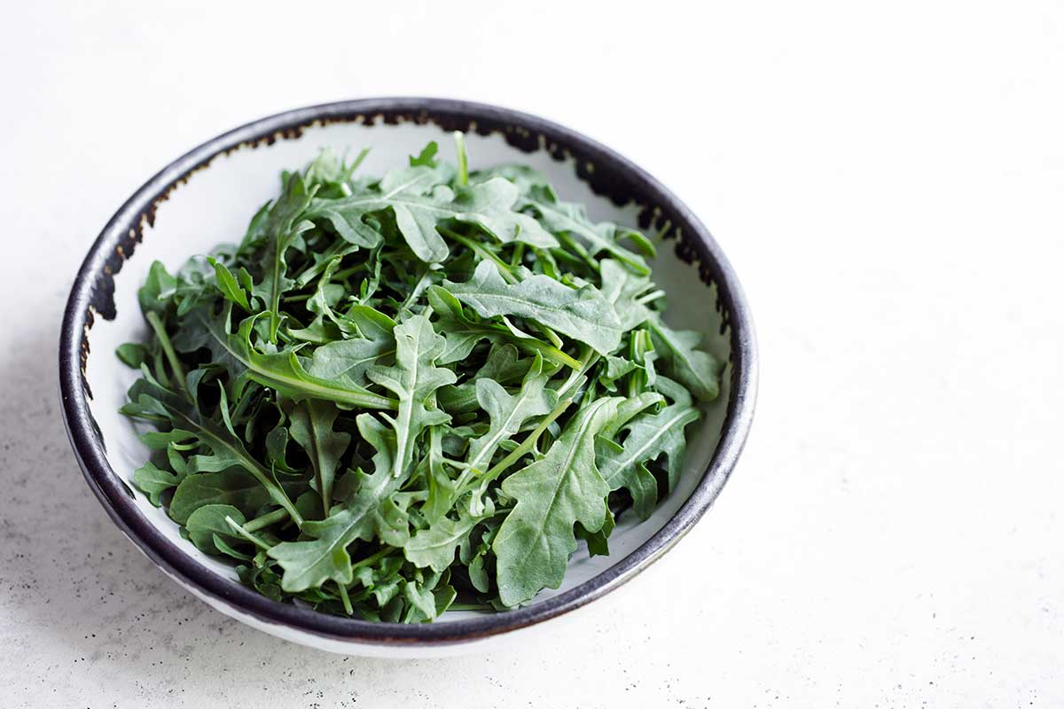 Baby arugula in a bowl