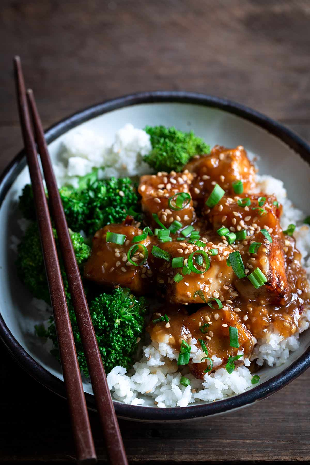 General Tso's Tofu with chopsticks to the left