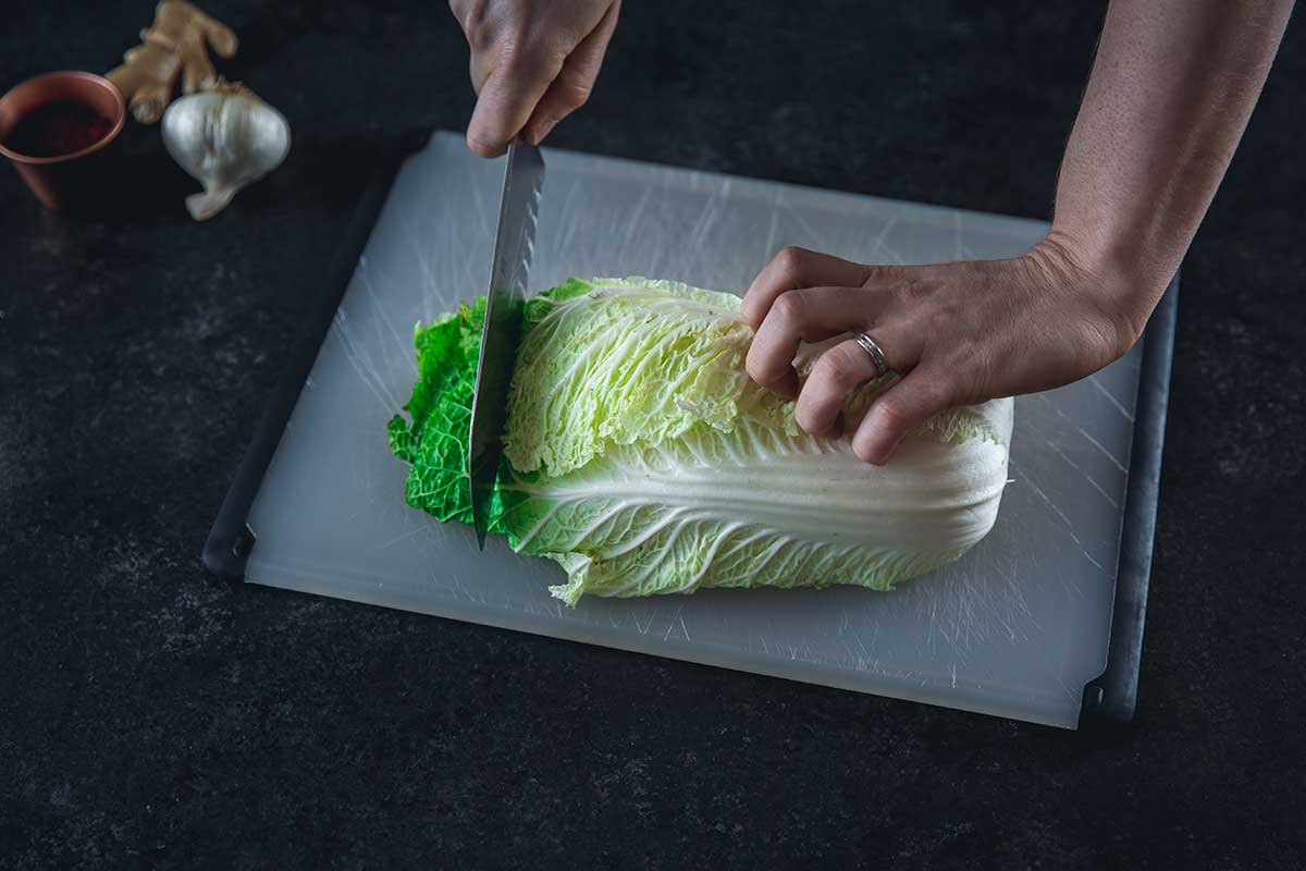 Slicing napa cabbage on a cutting board
