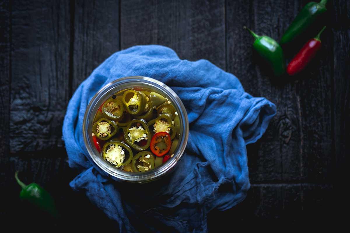 Pickled jalapeños in a mason jar