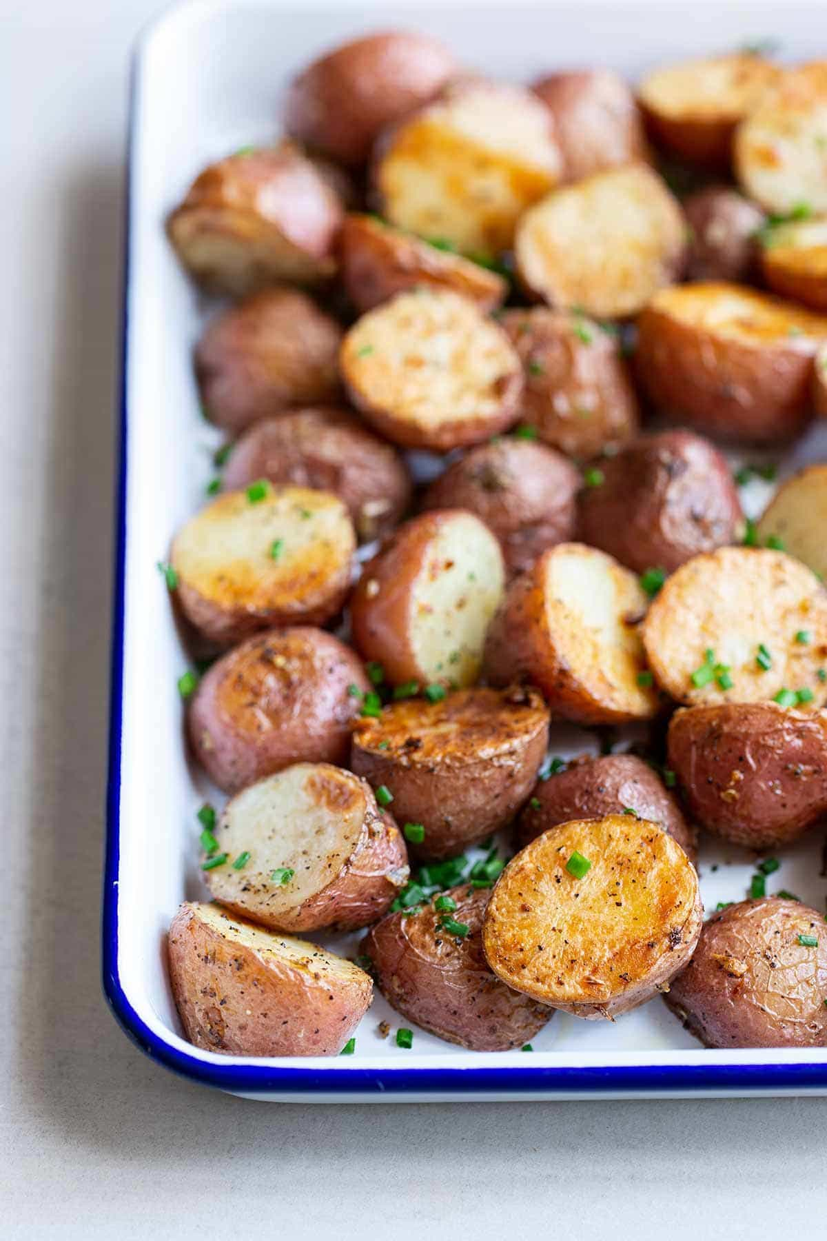 Oven-Roasted Potatoes in a white sheet pan