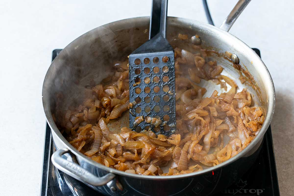 Caramelized onions in pan with spatula