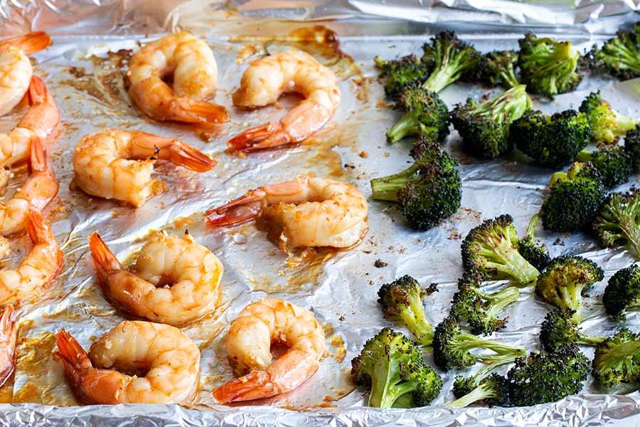 sheet pan honey garlic shrimp and broccoli cooked