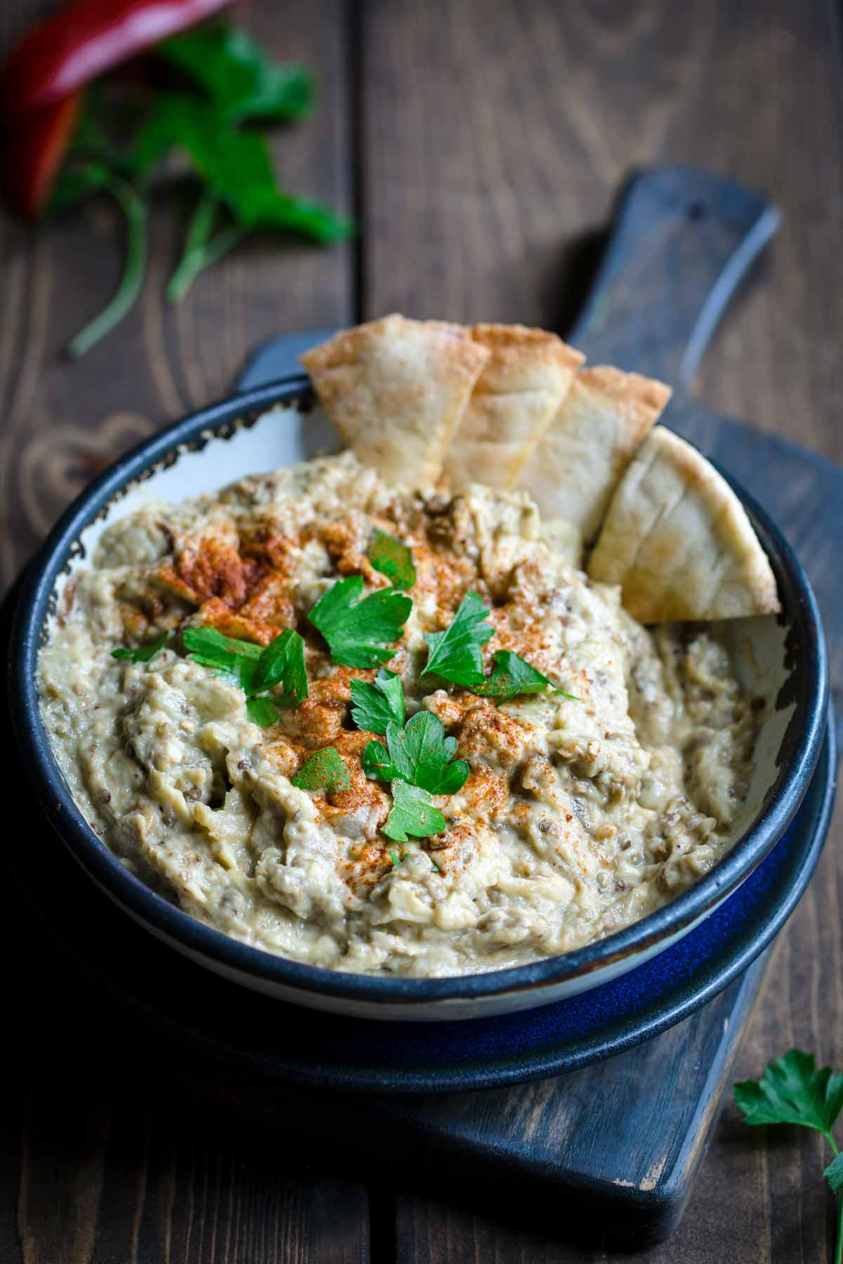 Baba Ganoush in bowl with pita chips on the side
