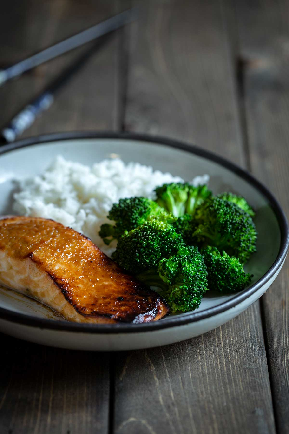 Miso salmon on plate with rice and broccoli