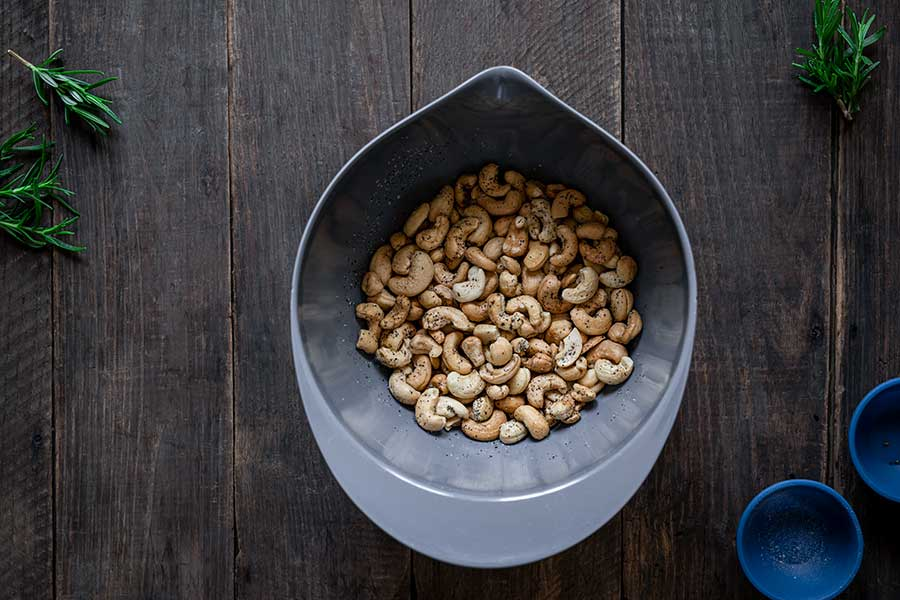 Rosemary salt-and-pepper toasted cashews tossed together in a bowl