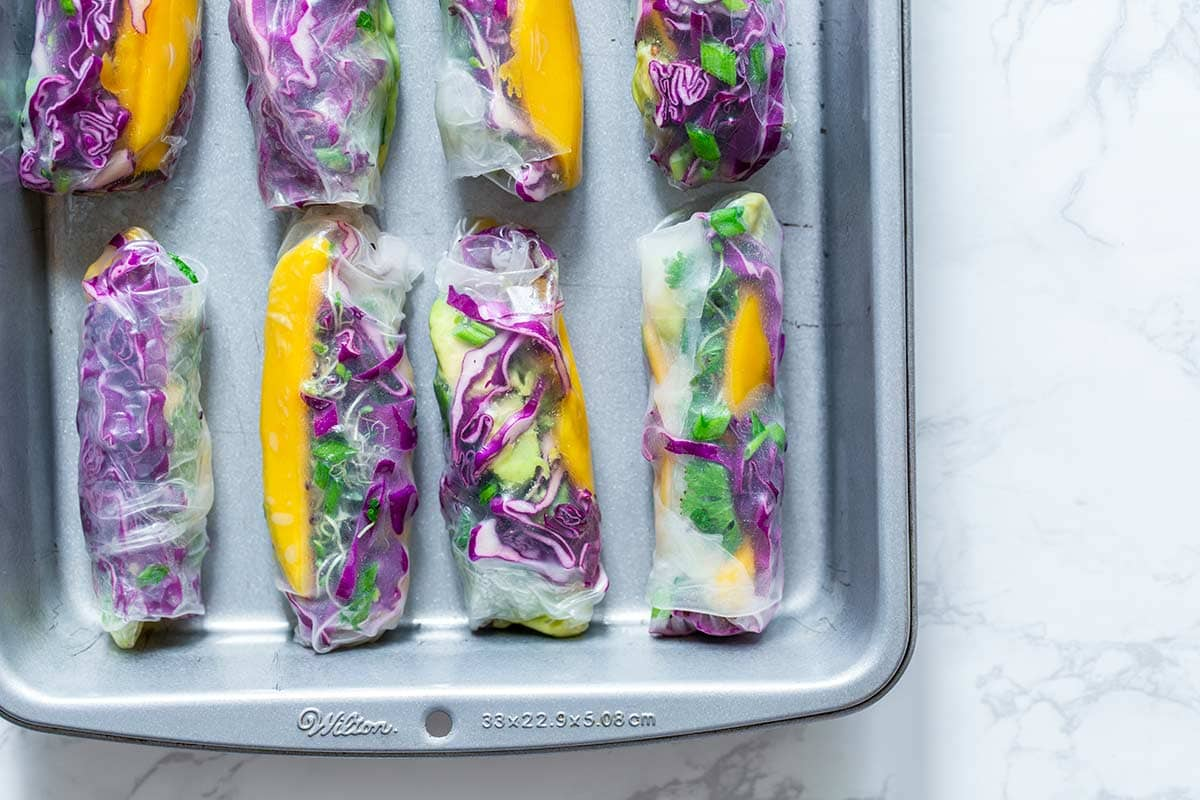 Many summer rolls in a lightly greased baking pan