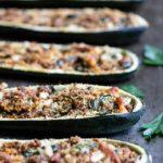 Side angle closeup of Italian sausage-stuffed zucchini boats recipe