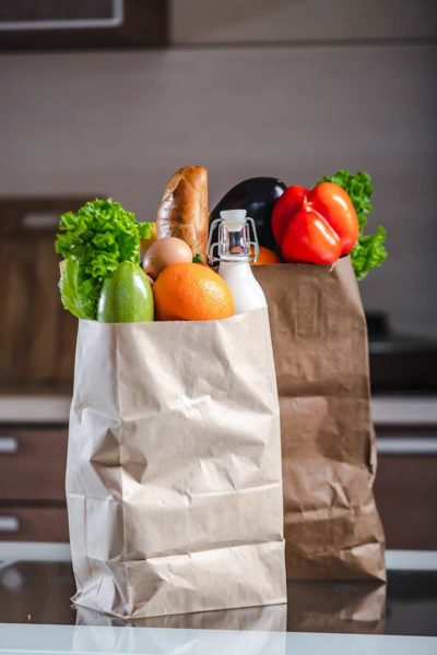 Pantry staples in two brown paper bags
