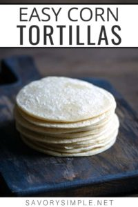 """A stack of homemade corn tortillas on a cutting board with text overlay """"easy corn tortillas"""""""